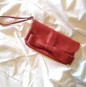 Also Red clutch bag